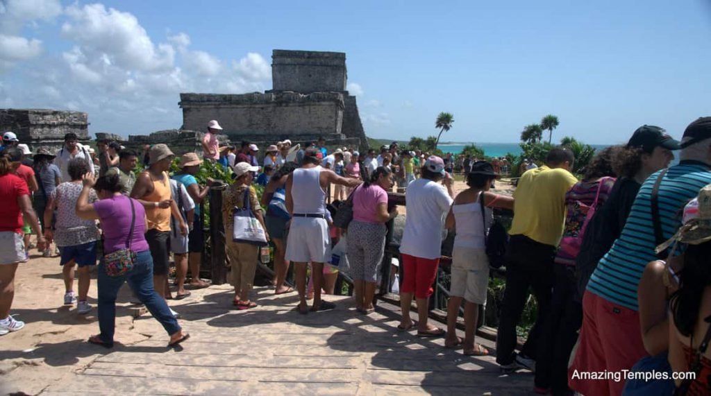 To late ! Tourists in front of the Castillo in Tulum - full size