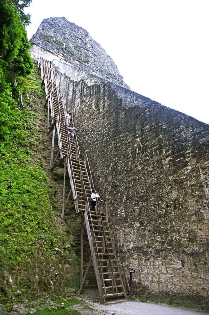 Tikal - TemTikal - Temple IV - Wooden stairs at the side to climb up to the top of the pyramidple IV