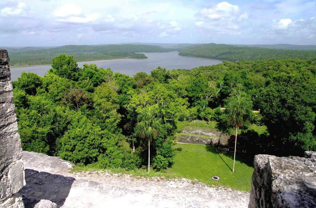 Yaxhá: Looking down the pyramid, in lake in the background